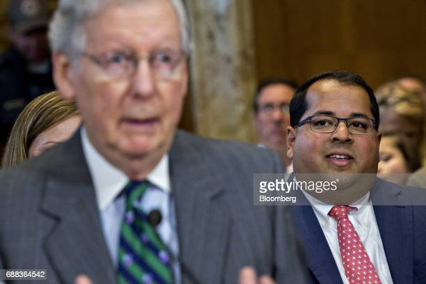 Neil Chatterjee nominee to be a member of the Federal Energy Regulatory Commission for US President Donald Trump right listens as Senate Majority...