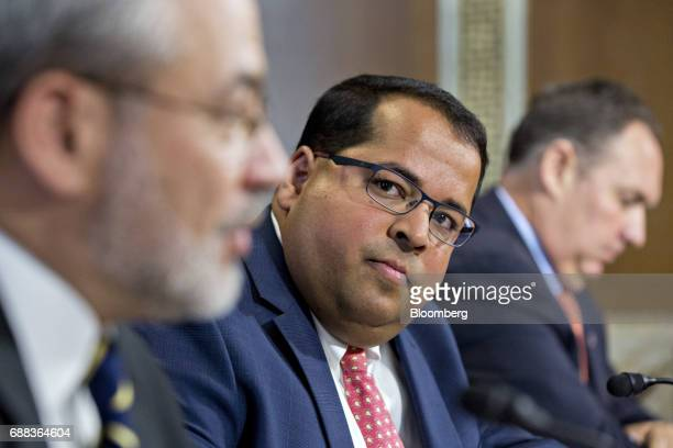 Neil Chatterjee nominee to be a member of the Federal Energy Regulatory Commission for US President Donald Trump listens during a Senate Energy and...