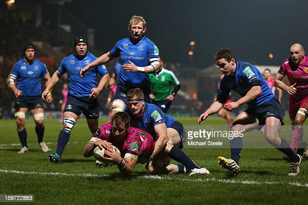 Neil Clark of Exeter Chiefs scoes his sides opening try as Jamie Heaslip of Leinster fails to tackle during the Heineken Cup Pool Five match between...