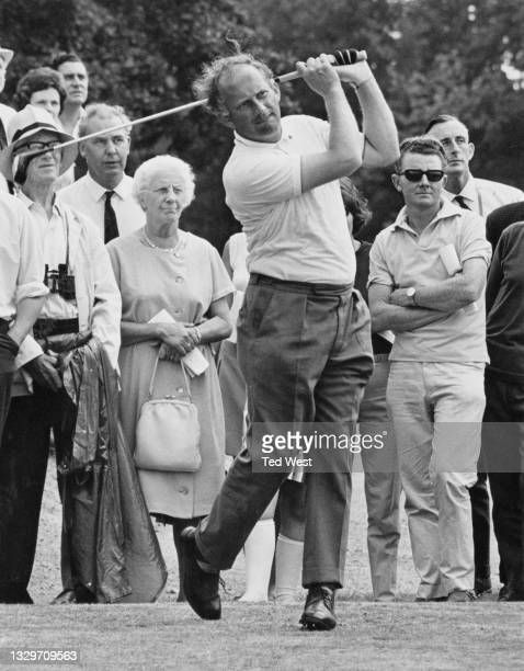 Neil Coles of Great Britain watches his drive off the 4th tee during the Esso Golden Golf Tournament on 22nd July 1967 at the Moor Park Golf Club in...
