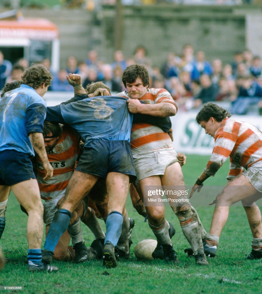 Neil Courtney of Wigan (red and white shirt, centre) pushing an opponent over the ball during their rugby league match on 5th April 1985.