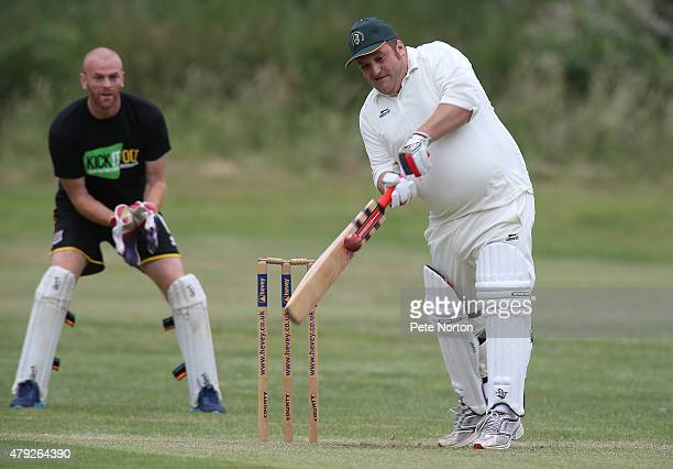Neil Cox of Bold Dragoon CC hits out during a 20/20 Cricket Match between Bold Dragoon CC and Northampton Town FC in aid of the Leon Barwell...