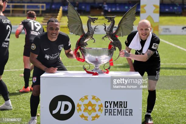 Neil Danns and Jamie Insall hold the trophy as Connah's Quay Nomads celebrate being champions of the Welsh / Cymru Welsh Premier League during the...