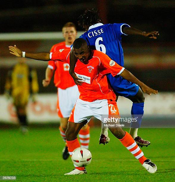 Neil Danns of Blackpool clashes with Aliou Cisse of Birminham during the Carling Cup second round match between Blackpool and Birmingham City at...