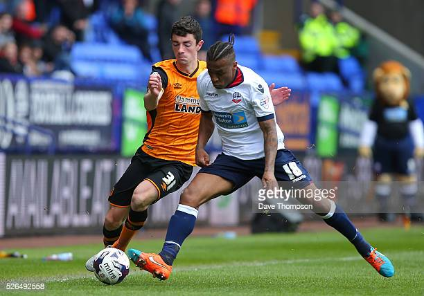Neil Danns of Bolton Wanderers and Brian Lenihan of Hull City compete for the ball during the Sky Bet Championship match between Bolton Wanderers and...