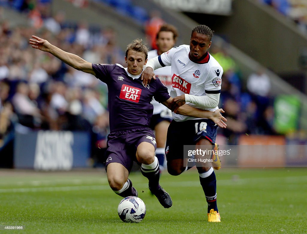 Neil Danns (R) of Bolton Wanderers and Stephen Warnock of Derby County battle for the ball during the Sky Bet Championship match between Bolton Wanderers and Derby County at the Macron Stadium on August 8, 2015 in Bolton, England.