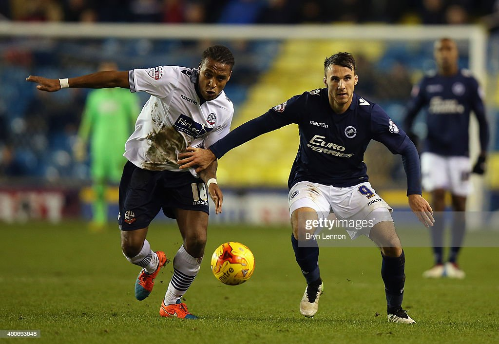 Neil Danns of Bolton Wanderers battles with Lee Gregory of Millwall during the Sky Bet Championship match between Millwall and Bolton Wanderers at The Den on December 19, 2014 in London, England.