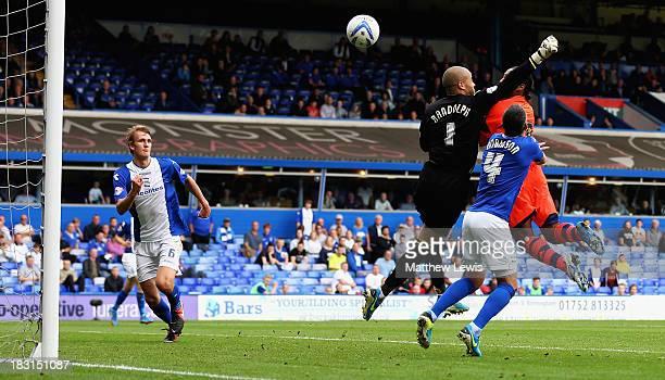 Neil Danns of Bolton Wanderers beats Darren Randolph of Birmingham City with a header to score a goal during the Sky Bet Championship match between...
