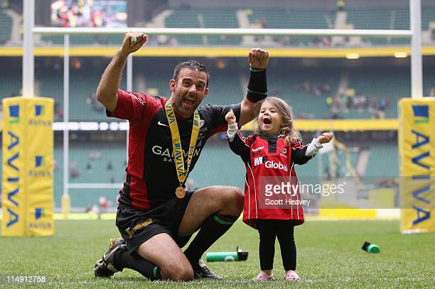 Neil De Kock of Saracens and his daughter Layla celebrate victory during the AVIVA Premiership Final between Leicester Tigers and Saracens at...