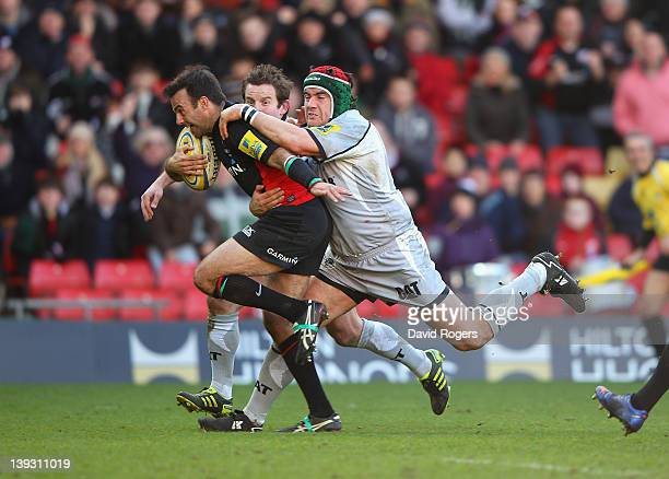 Neil de Kock of Saracens breaks clear of the the tackle from Marcos Ayerza to score the first try during the Aviva Premiership match between Saracens...
