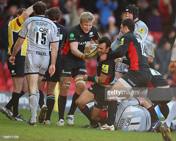 Neil de Kock of Saracens is congratulated by team mates after scoring the first try during the Aviva Premiership match between Saracens and Leicester...