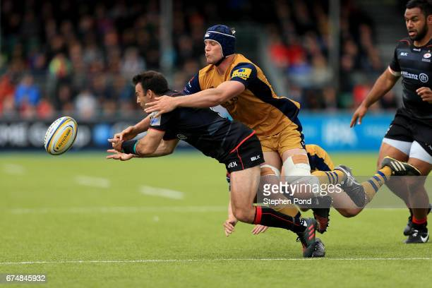 Neil De Kock of Saracens is tackled by Sam Jeffries of Bristol Rugby during the Aviva Premiership match between Saracens and Bristol Rugby at Allianz...