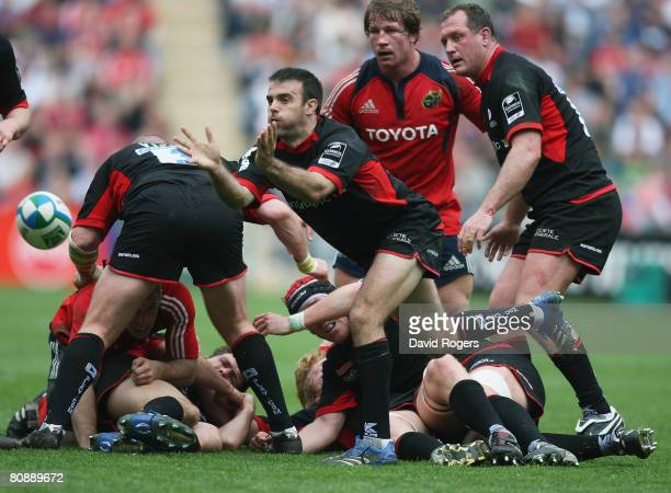 Neil De Kock of Saracens passes the ball away from a ruck during the Heineken Cup Semi Final match between Saracens and Munster at the Ricoh Arena on...