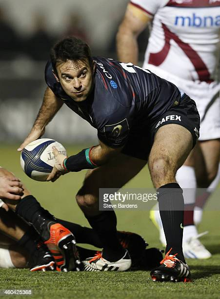 Neil De Kock of Saracens passes the ball during the European Rugby Champions Cup pool one match between Saracens and Sale Sharks at Allianz Park on...