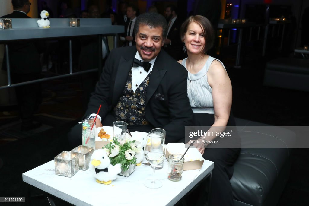 Neil deGrasse Tyson and Alice Young attend the 60th Annual GRAMMY Awards Celebration at Marriott Marquis Hotel on January 28, 2018 in New York City.
