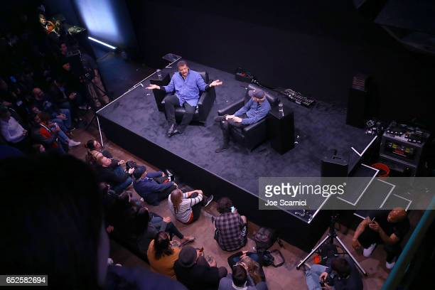 """Neil deGrasse Tyson and Ron Howard speak onstage at the """"Nat Geo Further Base Camp"""" at SXSW 2017 - Day 3 on March 12, 2017 in Austin, Texas."""
