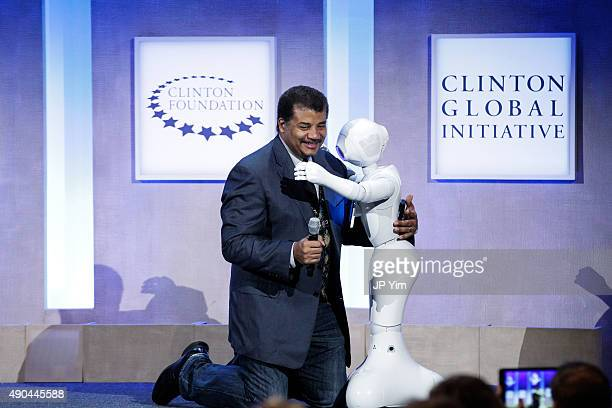 Neil deGrasse Tyson Astrophysicist American Museum of Natural History hugs Pepper Social Humanoid Robot at the Looking to the Next Frontier session...