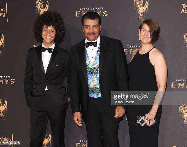 Neil deGrasse Tyson son Travis Tyson and wife Alice Young attend the 2017 Creative Arts Emmy Awards at Microsoft Theater on September 9 2017 in Los...