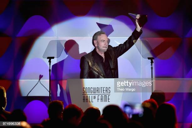 Neil Diamond accepts the Johnny Mercer Award onstage during the Songwriters Hall of Fame 49th Annual Induction and Awards Dinner at New York Marriott...