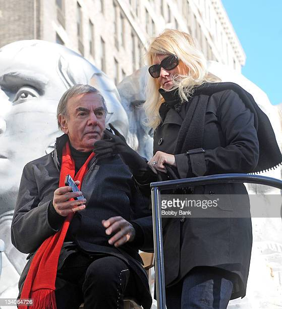 Neil Diamond and his fiance Katie McNeil walk in the 2011 Macy's Thangiving Day Parade in the streets of Manhattan on November 24 2011 in New York...