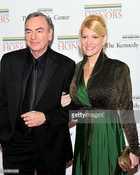 Neil Diamond and Katie McNeil arrive for the formal Artist's Dinner honoring the recipients of the 2011 Kennedy Center Honors hosted by United States...