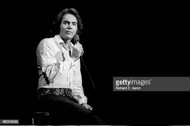 Neil Diamond performs live on stage during his 1976 tour of the USA