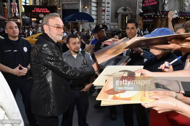 Neil Diamond signs autographs at the Songwriters Hall of Fame 49th Annual Induction and Awards Dinner at New York Marriott Marquis Hotel on June 14...