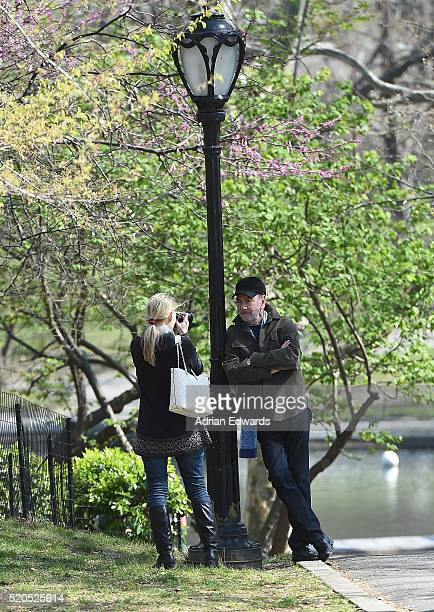 Neil Diamond with his wife Katie McNeil out for a stroll in Central Park is seen on April 11 2016 in New York City Katie is seen taking photos of her...
