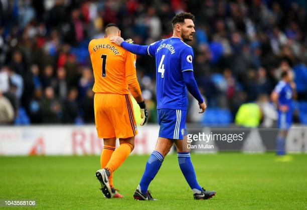 Neil Etheridge of Cardiff City and Sean Morrison of Cardiff City look dejected following their sides defeat in the Premier League match between...