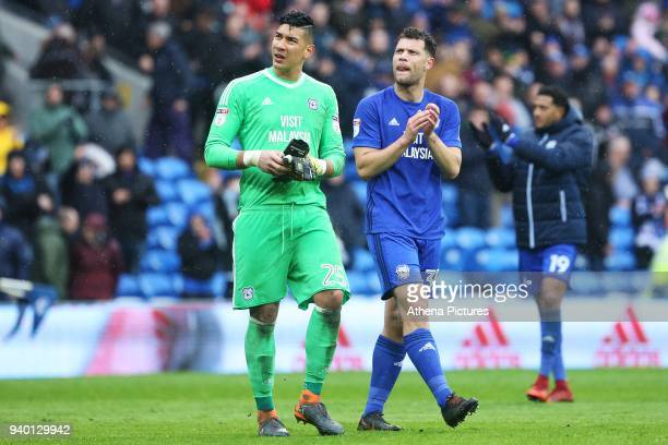 Neil Etheridge of Cardiff City and Yanic Wildschut the Sky Bet Championship match between Cardiff City and Burton Albion at the Cardiff City Stadium...