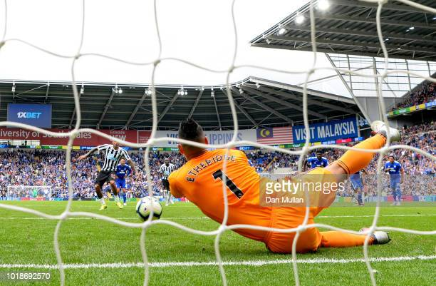 Neil Etheridge of Cardiff City dives to save a penalty from Kenedy of Newcastle United during the Premier League match between Cardiff City and...