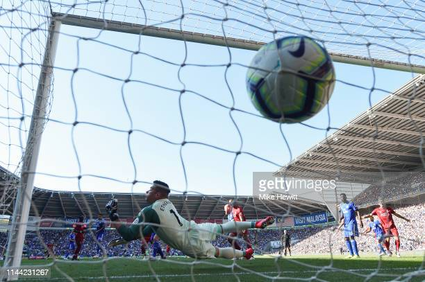 Neil Etheridge of Cardiff City fails to stop a shot from Georginio Wijnaldum of Liverpool during the Premier League match between Cardiff City and...
