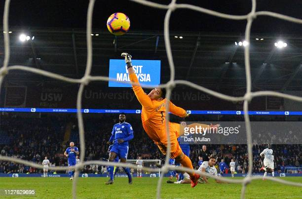 Neil Etheridge of Cardiff City fails to stop Dominic CalvertLewin of Everton from scoring his team's third goal during the Premier League match...