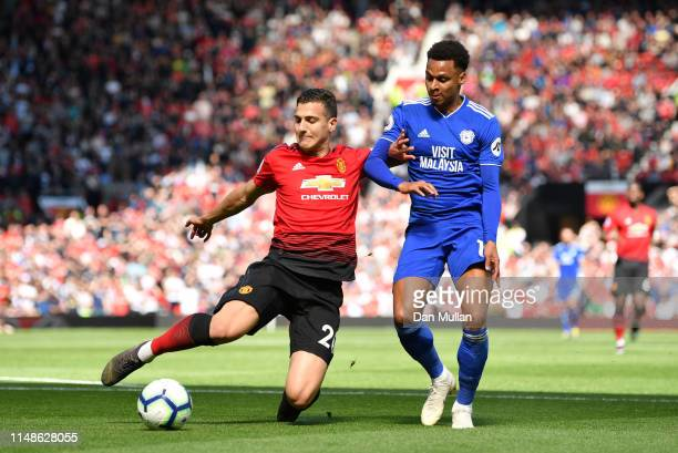Neil Etheridge of Cardiff City is challenged by Diogo Dalot of Manchester United during the Premier League match between Manchester United and...