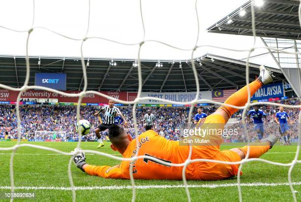 Neil Etheridge of Cardiff City saves a penalty from Kenedy of Newcastle United during the Premier League match between Cardiff City and Newcastle...