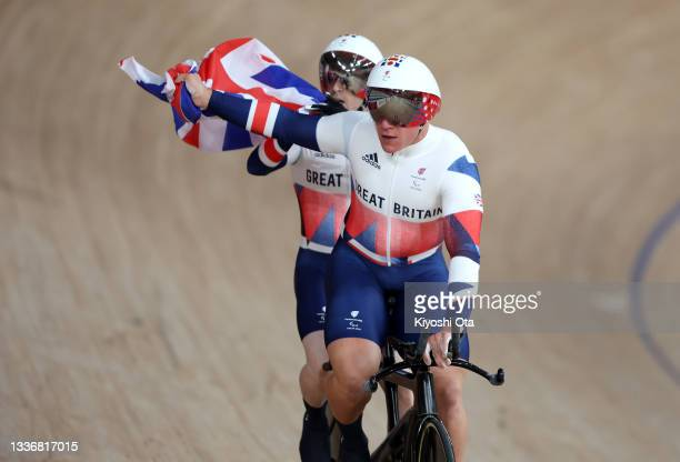 Neil Fachie and pilot Matthew Rotherham of Team Great Britain react after setting a new world record in the men's B 1000m Time Trial track cycling on...