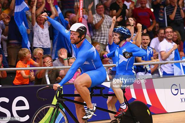Neil Fachie of Scotland and pilot Craig MacLean celebrate after winning gold in the Men's Sprint B2 Tandem Final at Sir Chris Hoy Velodrome during...