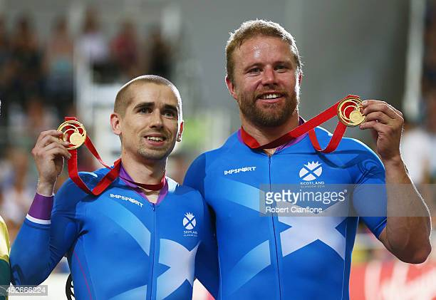 Neil Fachie of Scotland and pilot Craig Maclean pose with their gold medals during the medal ceremony for the Men's 1000m Time Trial B2 Tandem final...