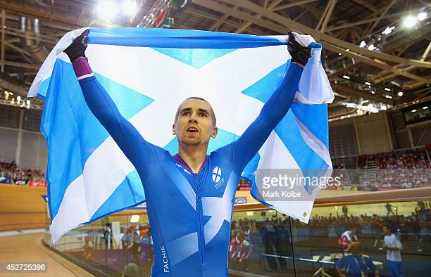 Neil Fachie of Scotland celebrates after winning gold in the Men's Sprint B2 Tandem Final at Sir Chris Hoy Velodrome during day three of the Glasgow...