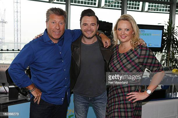 Neil Fox Shane Filan and Verity Geere pose during Magic 1054 FM's Live broadcast promoting London's Biggest Breakfast fundraising event on Thursday...