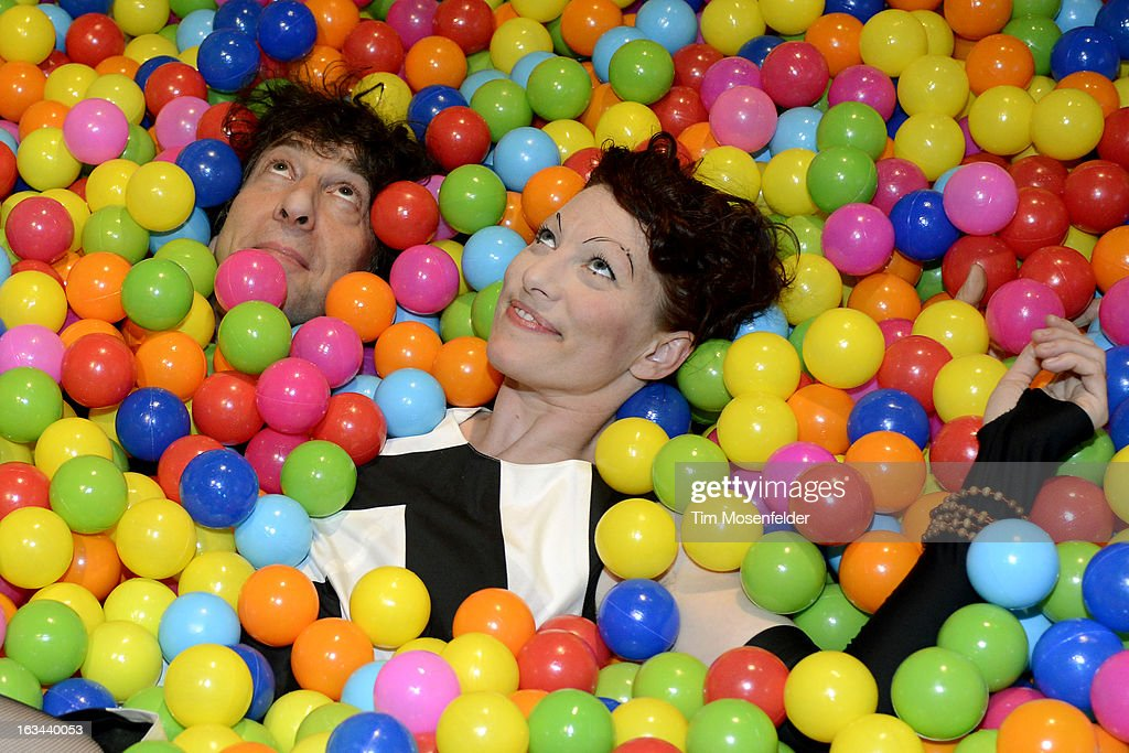 Neil Gaiman (L) and Amanda Palmer pose at the Warner Brothers TV 2013 SXSW party on March 9, 2013 in Austin, Texas.