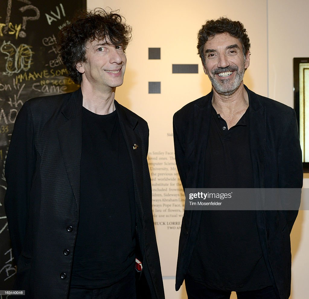 Neil Gaiman (L) and Chuck Lorre pose at the Warner Brothers TV 2013 SXSW party on March 9, 2013 in Austin, Texas.