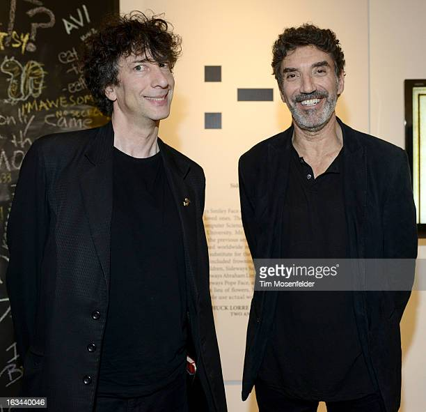 Neil Gaiman and Chuck Lorre pose at the Warner Brothers TV 2013 SXSW party on March 9 2013 in Austin Texas