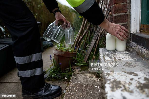 Neil Garner a milkman for the MilkMore delivery company works on his daily round in the Watford area north of London on March 23 2016 Once a daily...