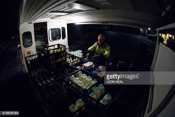 Neil Garner a milkman for the MilkMore delivery company works on his daily round in the Watford area north of London on January 21 2016 Once a daily...