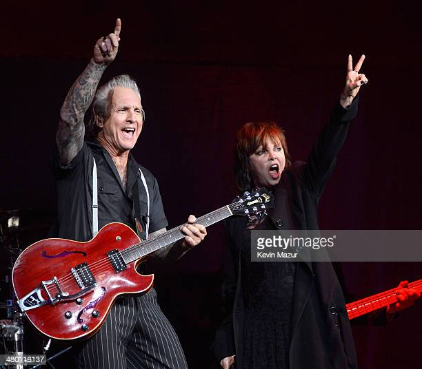"""Neil Giraldo and Pat Benatar perform onstage before Cher's """"Dressed To Kill"""" tour opener at US Airways Center on March 22, 2014 in Phoenix, Arizona."""