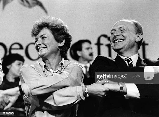 Neil Gordon Kinnock, Welsh Politician linking arms with his wife Glenys at the Labour Party Conference in Blackpool in 1986.