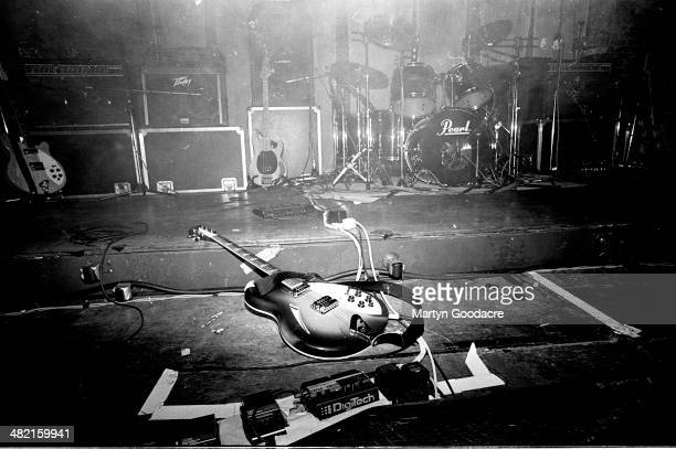 Neil Halstead of Slowdive's Rickenbacker 360 guitar lies on the stage by his effects pedals United Kingdom 1991