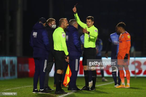 Neil Harris, Manager of Cardiff City is shown a red card by referee, Leigh Doughty during the Sky Bet Championship match between Wycombe Wanderers...