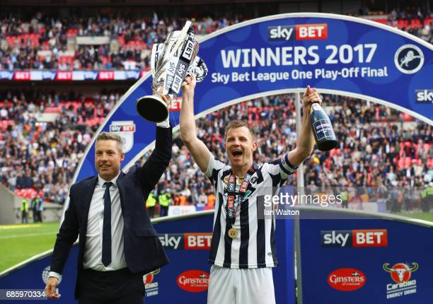 Neil Harris manager of Millwall and captain Tony Craig celebrate victory and promotion with the trophy after the Sky Bet League One Playoff Final...